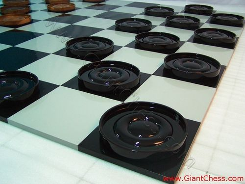 http://www.giantchess.com/manufacturer/chess_set/checker_pieces_24/source/image/checker_pieces_24_02.jpg